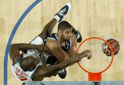 Emeka okafor dunks on tim duncan