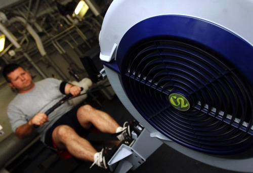 US Navy 070329 N 8923M 029 Lt Shaun Estep of Strike Fighter Squadron VFA 37 the Raging Bulls prepares for the physical readiness test PRT on a rowing machine