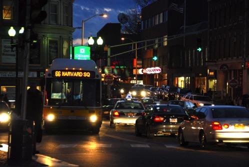 66 Bus in Harvard Square at night